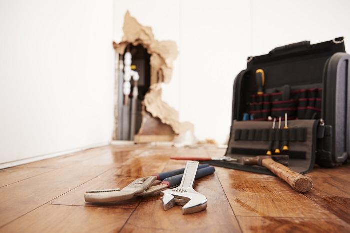 plumbing tools on the floor